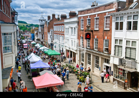 Guildford high street market in historic high street with shoppers on a busy summer market day Guildford Surrey - Stock Photo