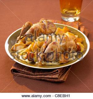 Free-range quails with spicy apples - Stock Photo