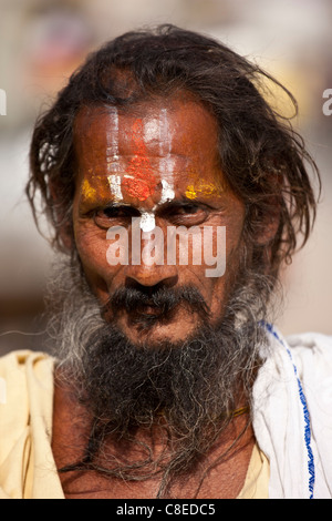 Hindu Sadhu holy man with traditional markings in street in Nandi near Varanasi, Benares, Northern India - Stock Photo