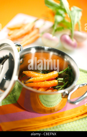 Cooking the carrots in a casserole dish - Stock Photo