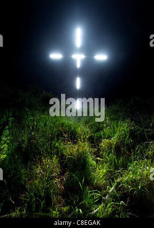 The lit up cross of Christians in Gordon's Bay, South Africa. - Stock Photo