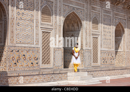 Muslim Punjabi girl at Tomb of Etimad Ud Doulah, 17th Century Mughal tomb built 1628, Agra, India - Stock Photo