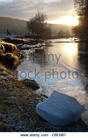 Blocks of pack ice on the banks of the River Stinchar, Ayrshire, Scotland - Stock Photo