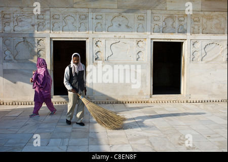 Man sweeping floor at Khas Mahal Palace built 17th Century by Mughal Shah Jehan for his daughters inside Agra Fort, - Stock Photo