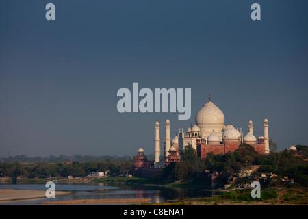 The Taj Mahal view and Yamuna River at sunset from Agra Fort, Khas Mahal Palace, India - Stock Photo