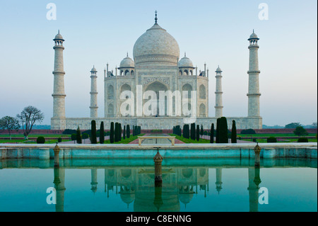 The Taj Mahal mausoleum southern view with reflecting pool and cypress trees, Uttar Pradesh, India - Stock Photo