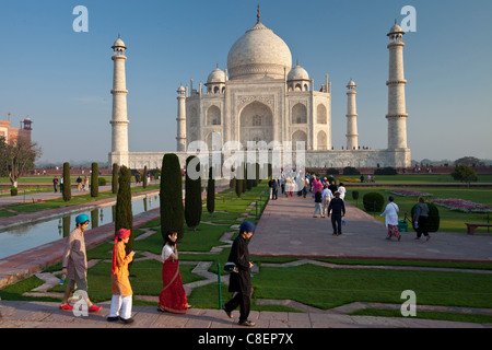 Asian tourists at The Taj Mahal mausoleum southern view Uttar Pradesh, India - Stock Photo