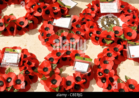 Poppy wreaths in the biggest British Cemetery of the Second World War, Bayeux, Normandy, France - Stock Photo