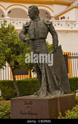 Statue of famous torrero Curro Romero in front of Plaza de Toros, La Maestranza, Seville, Andalucia, Spain - Stock Photo
