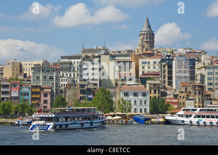 The Galeta tower (Galeta Kulesi) , built in 1348, Beyoglu district, with a ferry crossing the Golden Horn, Istanbul, - Stock Photo