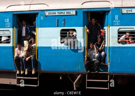 Indian people on crowded train at Bharatpur Station, Northern India - Stock Photo