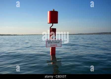 Red navigation marker in Portsmouth Harbour with 10 Knot speed restriction - Stock Photo
