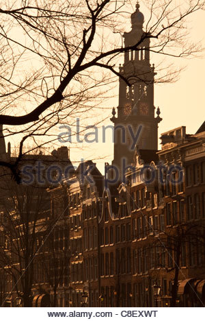 View along central canals with Westerkerk Church in background. - Stock Photo