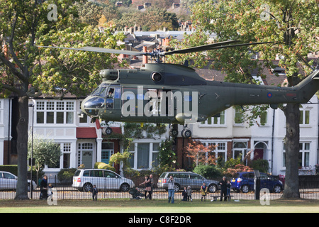 Locals are caught up in downdraft as ZA939, a Westland SA-330E Puma HC1 helicopter belonging to the RAF's 230 squadron, - Stock Photo