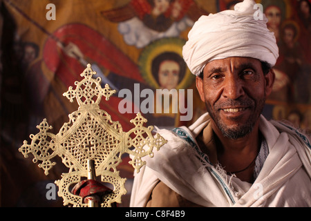Ethiopia lalibela a priest in one of the ancient rock for Christian kies