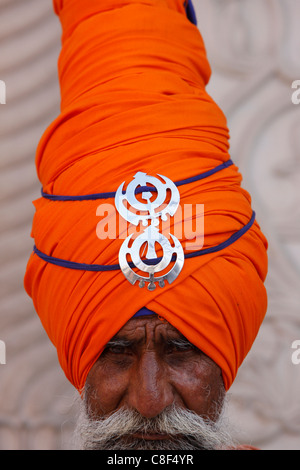 Sikh warrior in Gurdwara Sisganj, Old Delhi, India - Stock Photo