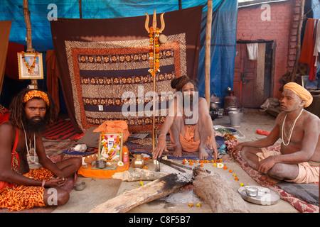 Naga sadhus in their akhara at the Kumbh Mela in Hardwar, Uttarakhand, India - Stock Photo