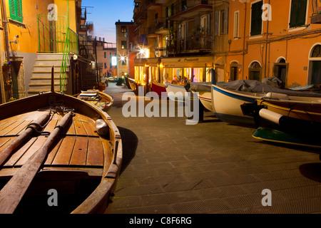 Manarola, Italy, Europe, Liguria, Cinque Terre, village, houses, homes, lane, boats, fishing boats, dusk, evening, - Stock Photo
