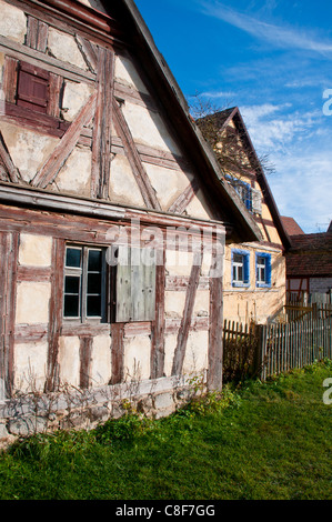 Old half timbered houses in the open air museum of Bad Windsheim, Franconia, Bavaria, Germany - Stock Photo