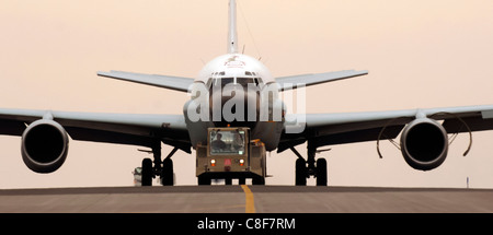 An RC-135 Rivet Joint reconnaissance aircraft is towed - Stock Photo