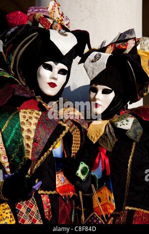 Costumes and masks during Venice Carnival, Venice, Veneto, Italy - Stock Photo