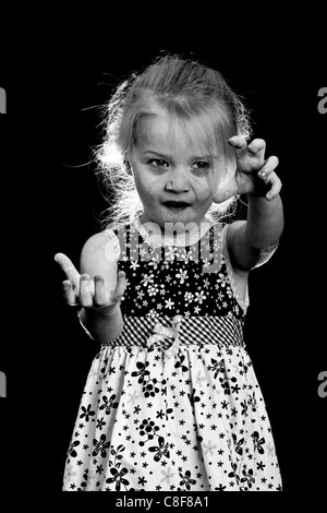 An extremely creepy Halloween image of an undead little girl. - Stock Photo
