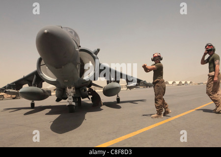 Marine Attack Squadron 513 ordnance technicians, disarm one of the squadron's AV-8B Harriers - Stock Photo