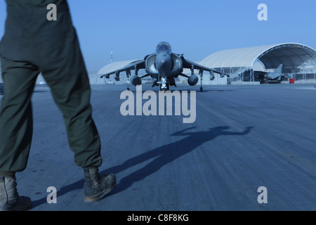 Marine Attack Squadron 513 ordnance technician prepares his AV-8B Harrier for an arming evolution on the flightline - Stock Photo