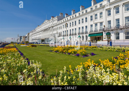 Hotels on the seafront promenade, flower filled gardens, Eastbourne, East Sussex, England, United Kingdom - Stock Photo