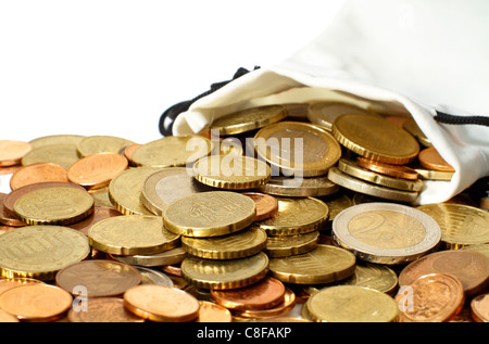 A white faux leather money bag of Euro coins spilled out on a white table. Focus is on the top coins just outside - Stock Photo