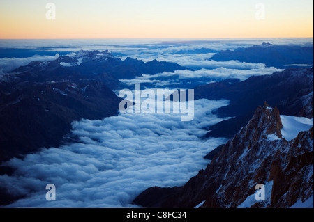 Sea of clouds below Aiguille du Midi cable car station, Mont Blanc range, Chamonix, French Alps, France - Stock Photo