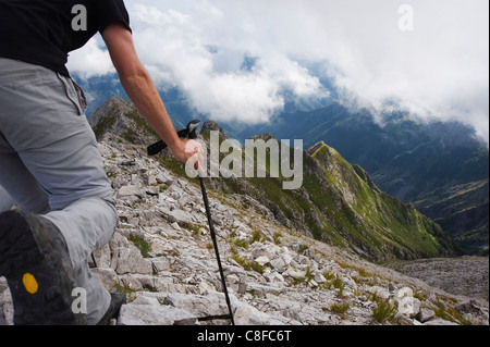 Hiker in the Apuan Alps, Tuscany, Italy - Stock Photo