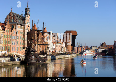 Old Town skyline in Gdansk city in Poland with Motlava river and the Crane on the far end - Stock Photo