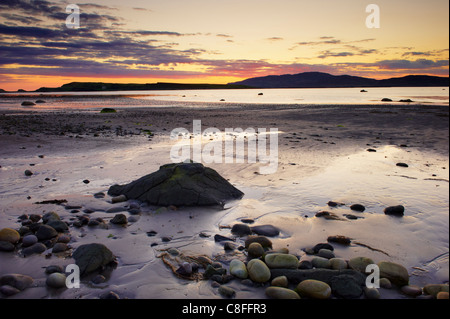 Sunset on Loch na Keal and Inch Kenneth island, Isle of Mull, Inner Hebrides, Scotland, United Kingdom - Stock Photo