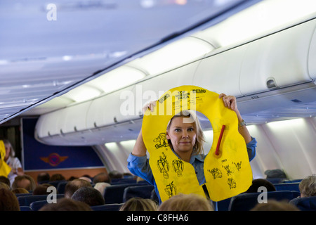 Southwest Airlines flight attendant instructs passengers on the use of the flotation device in Orlando, Florida - Stock Photo