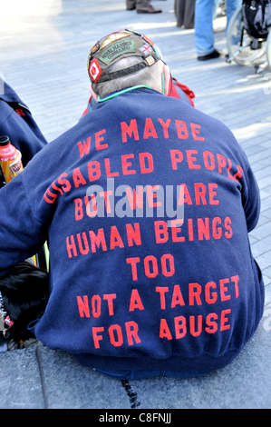 Welfare Reform Bill protest A disabled man with a slogan on his jacket at The Hardest Hit protest against benefit - Stock Photo