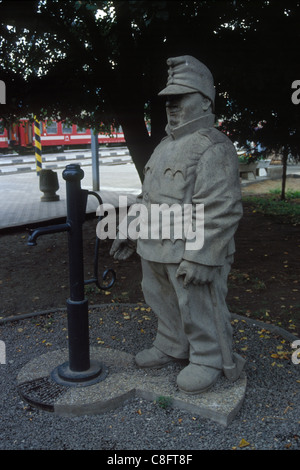 Monument to the good soldier Svejk at the railway station in Humenne, Slovakia. - Stock Photo