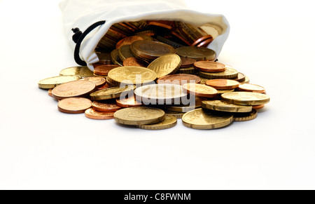 A faux leather, white money bag of modern Euro coins spilled out on a white surface. - Stock Photo