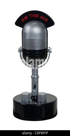 Retro pill audio microphone used to amplify communication with an on the air banner - path included - Stock Photo