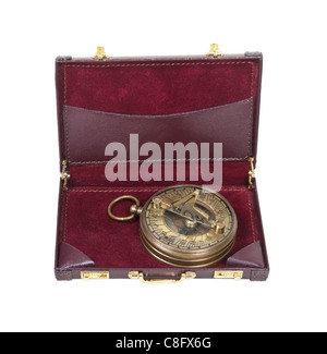 Brass sundial used to tell time as referenced by the sun in a leather briefcase - path included - Stock Photo