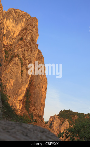 Sunset light over an emblematic rock in Turda's Canyon. - Stock Photo
