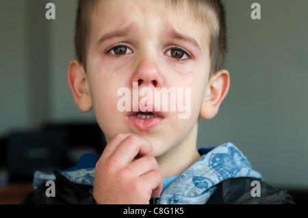 Sad child who is crying. Close up - Stock Photo