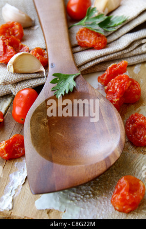 Old wooden spoon  on kitchen table - Stock Photo