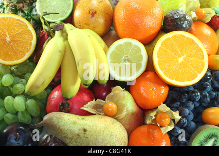 Mix of native and exotic fruits on a white background - Stock Photo