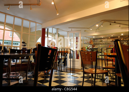 Tables and chairs in a welsh café uk - Stock Photo