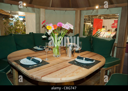 Table SettingsParis, France, Inside Modern Luxury Garden Cabin, Wooden Furniture on Display 'Crown Pavilions' Company, - Stock Photo
