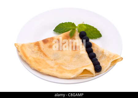 Light Crepe with blueberries, isolated on white background. - Stock Photo