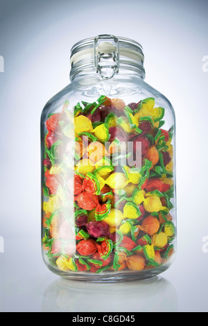 preserving jar filled with sweets - Stock Photo