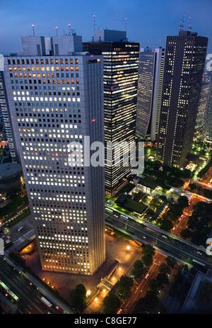 Evening skyline view of skyscraper corporate buildings in Nishi Shinjuku (West Shinjuku, Tokyo, Japan - Stock Photo