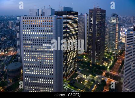 Evening skyline view of skyscraper high-rise corporate buildings in Nishi Shinjuku (West Shinjuku, Tokyo, Japan - Stock Photo